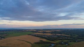Wheat fields. Beautiful scenery from a height in sunset time. Photos from the height Royalty Free Stock Images