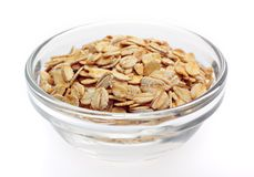 Wheat flakes in bowl Stock Photography