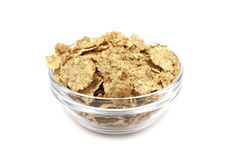Wheat flakes in a glass container Royalty Free Stock Images