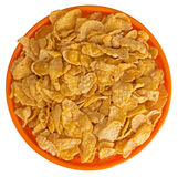 Sunshiny orange bowl of breakfast cereal cornflakes, isolated Royalty Free Stock Photo