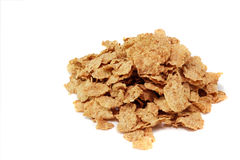 Wheat Flakes. A pile of wheat flakes on a white background Stock Photo