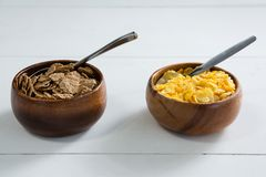 Wheat flakes and wheaties cereal in bowl Royalty Free Stock Photos