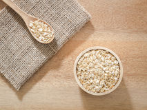 Wheat flakes in wooden bowl Royalty Free Stock Image