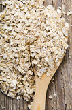 Wheat flakes wooden spoon on the table Royalty Free Stock Image