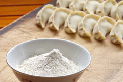Wheat flour in bowl and dumpling Royalty Free Stock Images