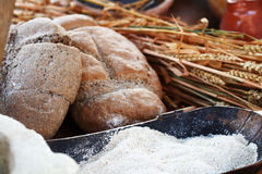 Wheat, flour and bread. In a market Stock Photos