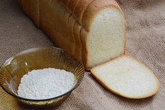 Wheat flour and bread Stock Image
