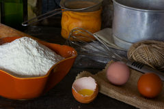 Wheat flour, broken egg and cooking utensils for cooking test Stock Image