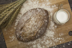 Wheat flour with a fresh  hot bread   and milk. Wheat flour with a fresh  hot bread and milk on the table Royalty Free Stock Photos