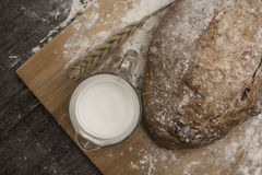 Wheat flour with a fresh  hot bread   and milk. Wheat flour with a fresh  hot bread and milk on the table Stock Image
