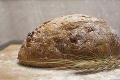 Wheat flour with a fresh  hot bread. On the table Stock Photos