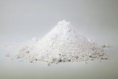 Wheat flour heap on white background Stock Photos