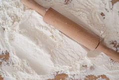 Wheat flour heap. On wooden background Royalty Free Stock Image