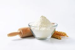 Wheat flour and rolling pin Royalty Free Stock Photography