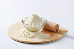 Wheat flour and rolling pin Stock Photography