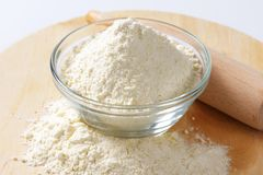 Wheat flour and rolling pin Royalty Free Stock Photos