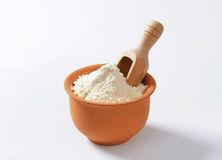 Wheat flour in terracotta dish Royalty Free Stock Photo