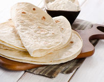 Wheat Flour Tortillas. On wooden board. Selective focus royalty free stock photos