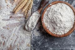 Free Wheat Flour With Scoop And Wheat Ears On Kitchen Board Top View. Ingredient For Baking Stock Photography - 172176662