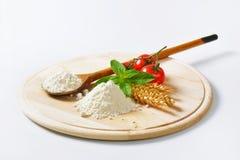 Wheat flour on wooden board Stock Image