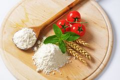 Wheat flour on wooden board Stock Images