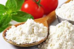 Wheat flour on wooden spoon Stock Photos