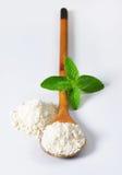 Wheat flour on wooden spoon Stock Image