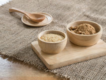 Wheat germ and  Brown sugar in wooden bowl Stock Photography