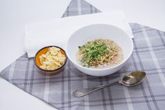 Wheat germs, bowl of corn flakes on served table. Ecology concept: Wheat germs in a bowlwith green bamboo Royalty Free Stock Photos