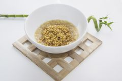 Wheat germs in bowl. Wheat germs in white bowl, bamboo sprout Royalty Free Stock Photo