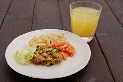 Wheat gluten on leek with couscous on a table. Wheat gluten on leek with couscous on a wooden table Stock Images