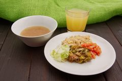 Wheat gluten on leek with couscous on a table. Wheat gluten on leek with couscous on a wooden table Stock Photography