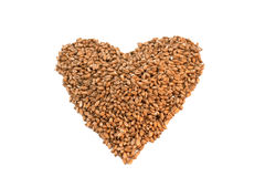 Wheat grain. Heart shaped wheat grain isolated on white background Stock Photo