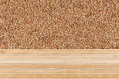 Wheat grain and bamboo mat Stock Photography