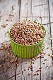 Wheat grain in bowl Stock Photo