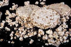 Wheat grain crispbread on black background, in low key, diet eating Royalty Free Stock Images