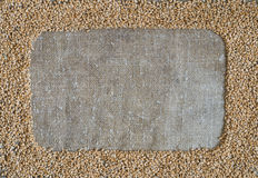Wheat grain in the form of a frame on burlap Stock Image
