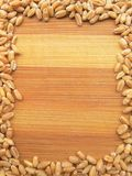 Wheat grain frame on wooden background Stock Image