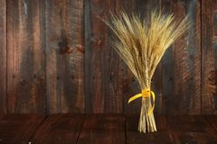 Wheat Grain Stalks on Grunge Wooden Background Stock Photos