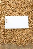 Wheat grain on wood texture Stock Photos