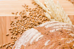 Wheat grains and bread Stock Photos