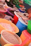 Wheat Grains, Flour and Pulses in Plastic Bowls on Mexican market Stall. stock images