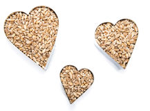 Wheat Grains in heart shapes (on white) Stock Image