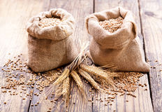 Wheat grains in sacks Stock Photo