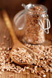 Wheat grains in the spoon Stock Photography