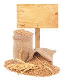 Wheat grains with wooden price tag Stock Image