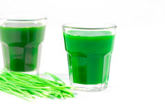 Wheat grass juice on white background Stock Photography