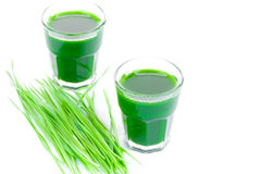Wheat grass juice on white background Royalty Free Stock Photo