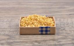 Wheat groat on wood Royalty Free Stock Image