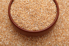 Wheat groats in bowl Royalty Free Stock Image